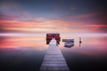 Fototapeta Footbridge to a lonely house in sea in Poland
