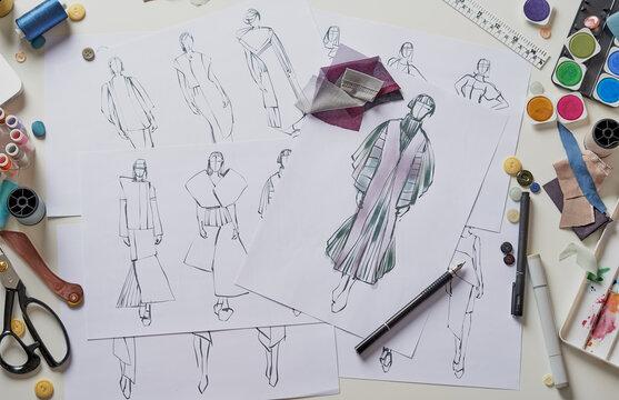 Fashion designer stylish drawings sketches textile fabric material Costume. Designer creative workshop studio.