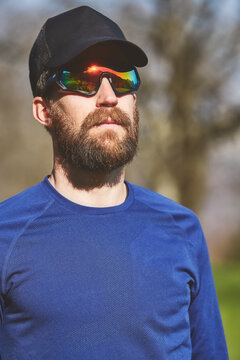 Portrait of young sporty man with beard with sunglasses