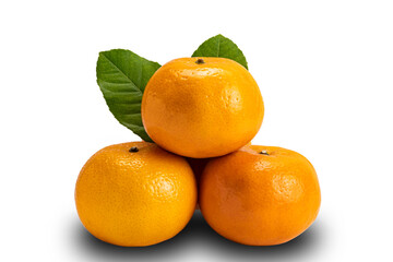 Fototapete - Closeup view of ripe Mandarin oranges with leaves on white background with clipping path. Mandarin orange is sweet, full of fiber and vitamin c.