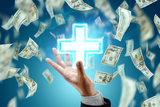 Falling Dollars and an image of a medical cross, a symbol of medicine. The concept of the cost of modern medicine, expensive services of doctors, the cost of drugs.