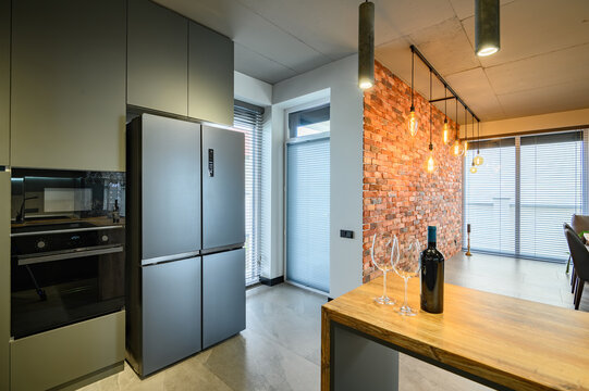 Modern large and luxurious dark gray kitchen with kitchen counter