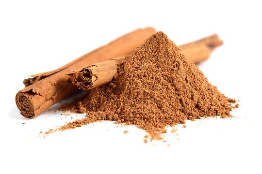 Ceylon Cinnamon or True Cinnamon Powder with added Cane Sugar and Quills (Sticks). Cooking Ingredient. Cinnamomum Verum. Isolated on White.