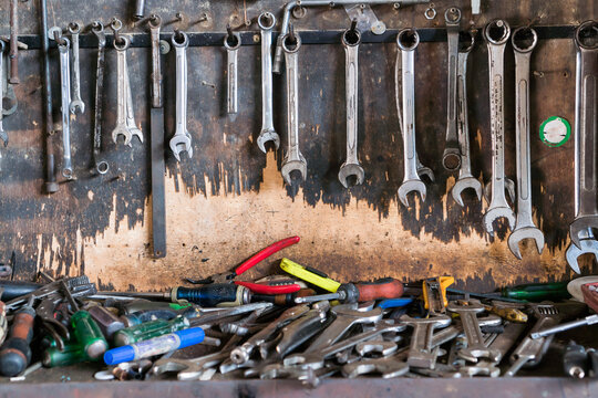Tools equipment on wall against for Fix mechanic garage in workshop inustrial, diy, hammer, iron