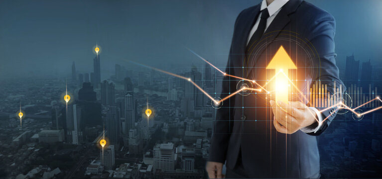 Businessman holding big arrow and graph growth of business, Abstract of financial and investment, Analysis, Strategy and planning, Economic growth chart, Progress or success concept.
