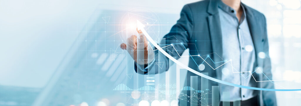 Businessman pointing arrow graph growth and financial network connection, analysing data to increase sales and revenue profit to achieve business investment goal in global economic situation.