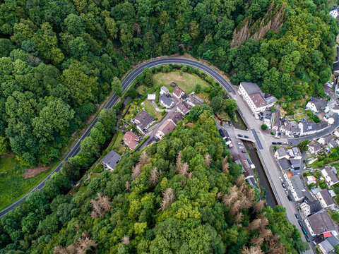 Winding road serpentine from a high pass in the rhine village Isenburg near Bendorf Sayn Germany Aerial view