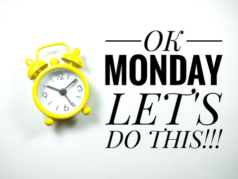 Word OK MONDAY LET'S DO THIS with yellow clock on white background.Motivation quote.