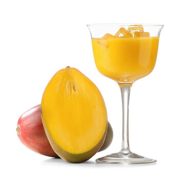 Glass of tasty mango margarita on white background