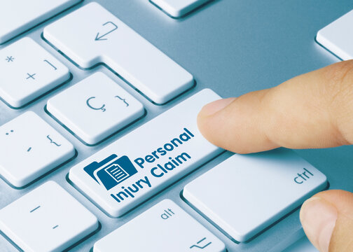 Personal Injury Claim - Inscription on Blue Keyboard Key.
