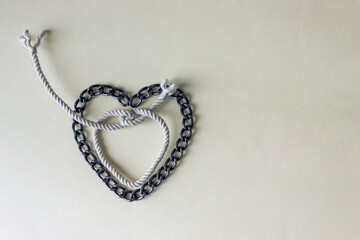 The chain is laid out in the shape of a heart. The concept of a problem relationship, dependence on a partner.
