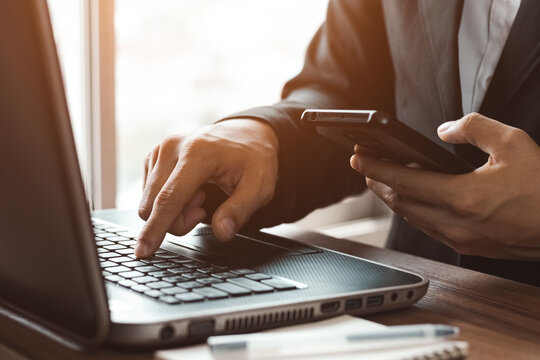 Work using mobile phone typing computer mobile chat laptop contact us at workplaces, planning ideas investors internet searching, ideas connecting people.
