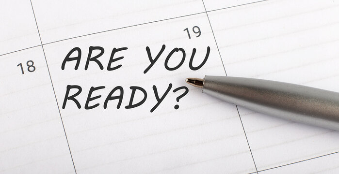 Text ARE YOU READY written on calendar planner to remind you an important appointment with a pen on isolated white background.