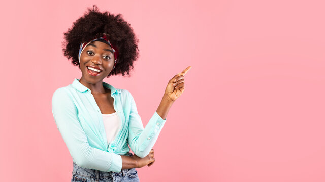 Black Woman Pointing Finger Aside Standing Over Pink Background, Panorama