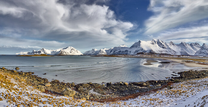 Winter landscape in panorama with snow covered mountains and fjord on the Lofoten in northern Norway
