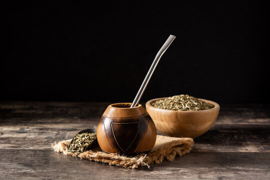 Traditional yerba mate tea on wooden table