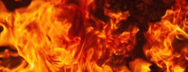 Dramatic pictures of fire flame background as symbol of hell and eternal pain. Horizontal image for design