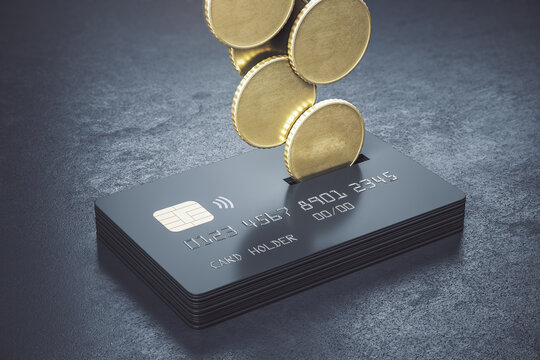 Cashback loyalty programm concept with metal coins bound for a stack of black credit cards on abstract dark surface
