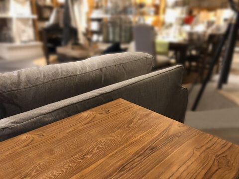 Empty rustic or vintage wooden table top corner in living room of the background