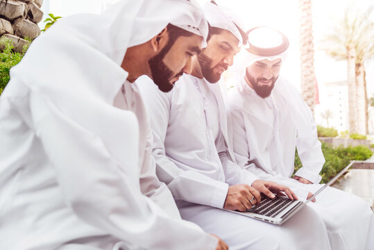 Three arabic men talking about business outddor