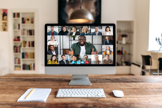 Distant online video meeting. A group of business people of different nationalities gathered from different parts of the world for communication and discussion of business issues via video conference