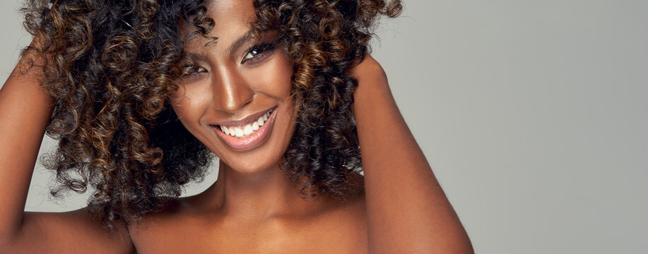 Close-up portrait of smiling black woman