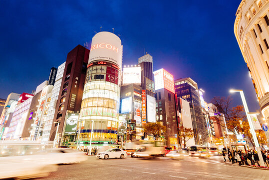 Tokyo, Japan - December 10, 2015: The famous Ricoh billboard building and night traffic at Ginza district at night and is one of the most famous city night views in Japan.