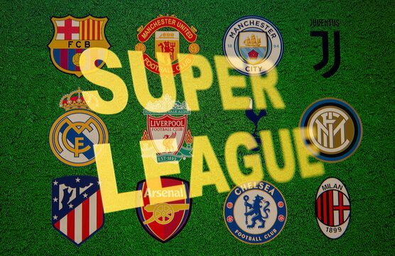 Super League words are seen in front of twelve of Europe's top football clubs logos in this illustration