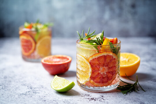 Red orange lime lemon cocktail in a glass