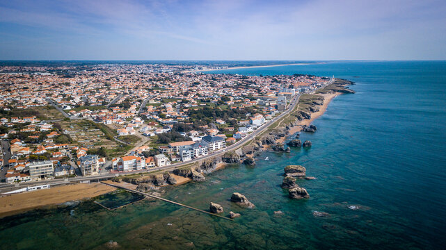 """Aerial view from a magnificent coastline between cliffs, beaches, clear water and city. That place is called """"Les 5 pineaux"""" located in Saint-Hilaire-de-Riez, France"""