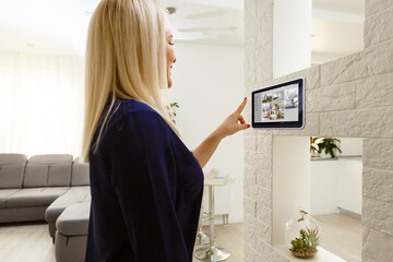 Woman having a Home automation control station in a modern home 3D render Wall mural
