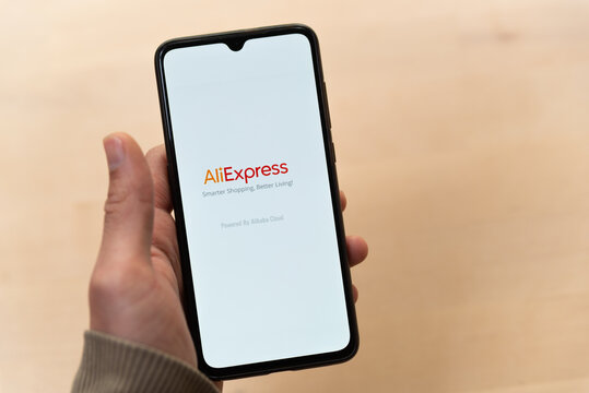 Barcelona, Spain - 20 april 2021: a hand holds a mobile phone ecommerce Aliexpress application open. aliexpress is a popular online shopping app