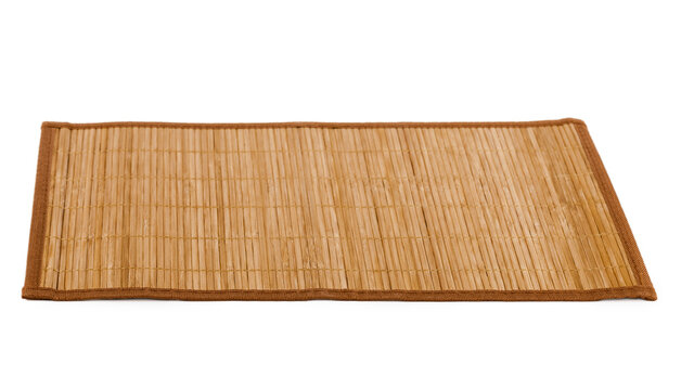 Bamboo straw serving mat isolated over white background.
