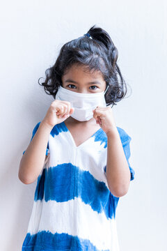 Asian Little girl  wearing a face mask . Standing posture ready for boxing. The concept of don't let your guard down during coronavirus pandemic outbreak.
