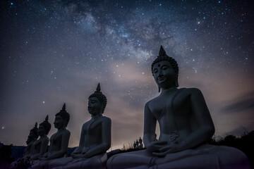 Fototapeta Milky way galaxy over many of buddha statues at Phu Phra Ban Mak Khaeng, Dan Sai, Loei, Thailand.