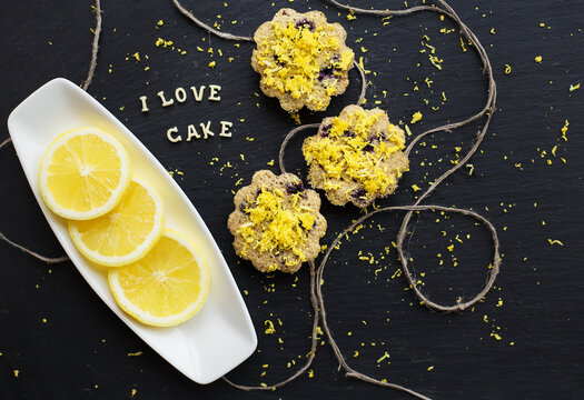 lemon cupcakes on a black background