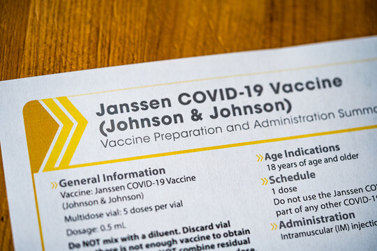 Washington, DC, USA - April, 1, 2021: Janssen COVID-19 Vaccine (Johnson and Johnson) Vaccine Preparation and Administration summary on wooden surface. Close up view.