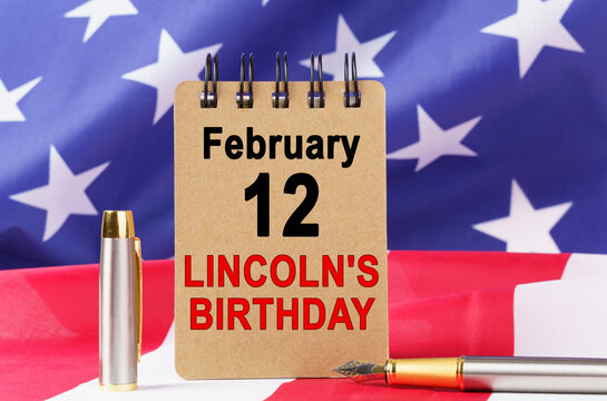 Against the background of the US flag lies cardboard with the inscription - LINCOLNS BIRTHDAY