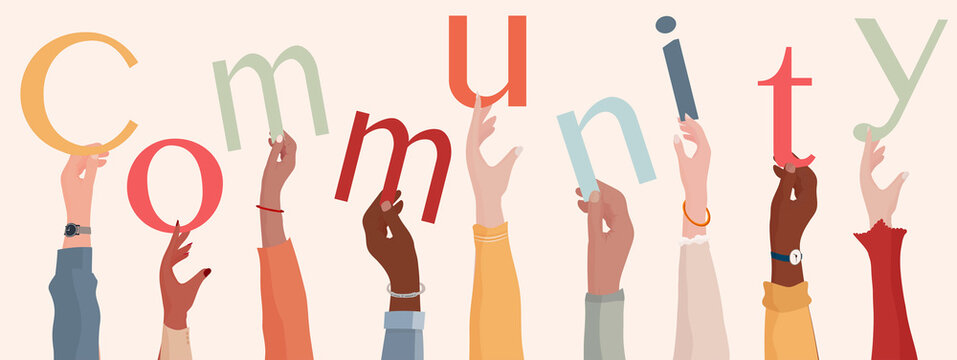 Group of raised hands holding the text Community. People diversity.Teamwork or community cooperation concept. Connection between diverse people.Communication and sharing.Racial equality