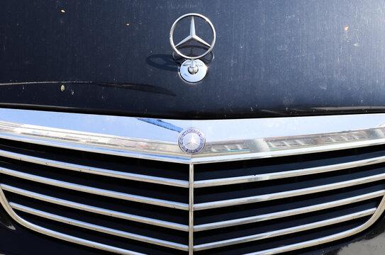 KIEL, GERMANY - Apr 16, 2021: Closeup of the Mercedes Benz logo on a new car front