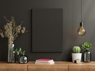 Fototapeta Mockup frame on cabinet in living room interior on empty dark wall background.