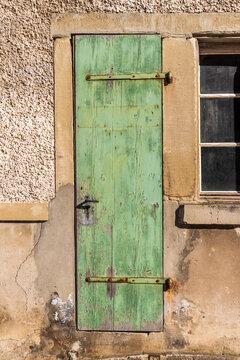 old green door in an old fabric in Switzerland