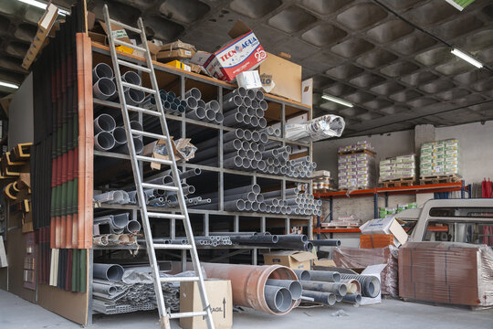 PLASENCIA, SPAIN - Feb 18, 2021: A shelf of a building products company full of pvc pipes