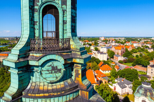 Panoramic view of old town historic city center with tower coping of Cathedral of Virgin Mary Assumption and St. Wojciech at Lech Hill in Gniezno, Poland