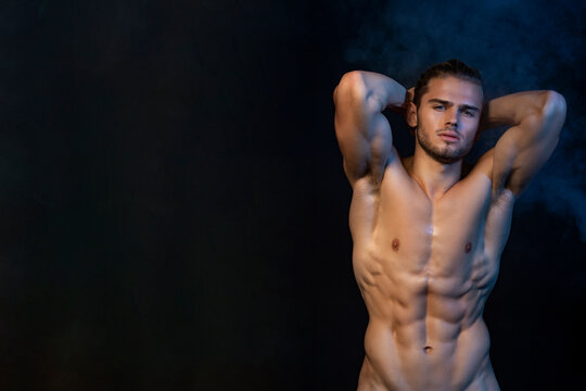 Sexy sport muscle fit strongface guy stripped on black isolated  font background with smoke