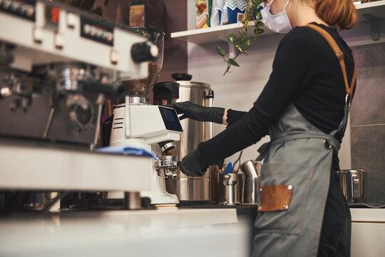 Hard-working barista preparing a good cup of coffee