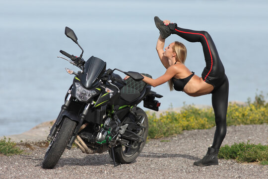 young woman with a sports motorcycle