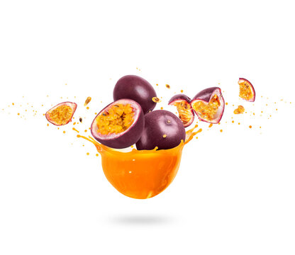 Sliced ripe passion fruits (Passiflora) with splashes of fresh juice, isolated on a white background