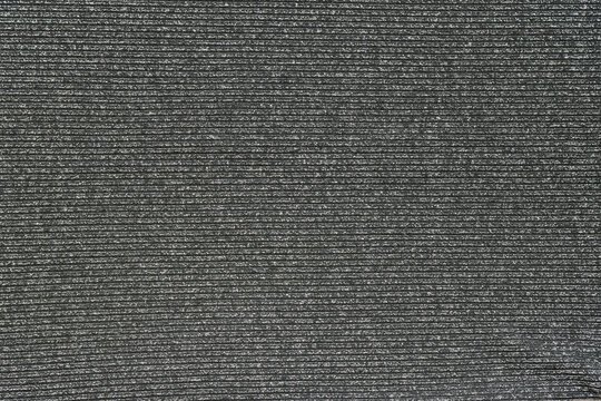 gray background from knitted fabric with lurex thread
