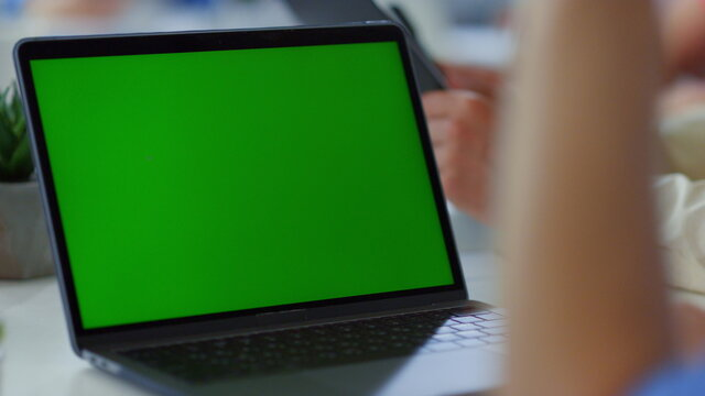 Unknown man having video call green screen laptop. Male person waving hand.
